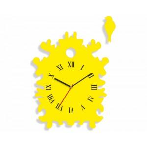Žluté hodiny na stěnu atypického tvaru