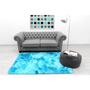 Ombre plyšový koberec modré barvy
