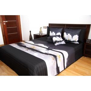 Černý přehoz na postel s bílými orchidejemi
