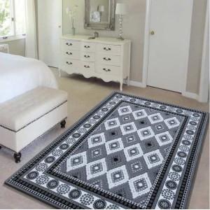 Stylový šedý koberec do ložnice