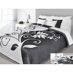 Přehoz na postel bílé barvy s černými vzory