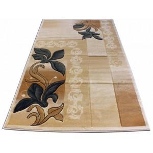 Béžový koberec se zeleným květem