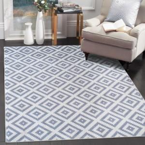 Šedý koberec v skandinávském stylu