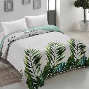 Prošívaný oboustranný přehoz na postel s tropickým motivem
