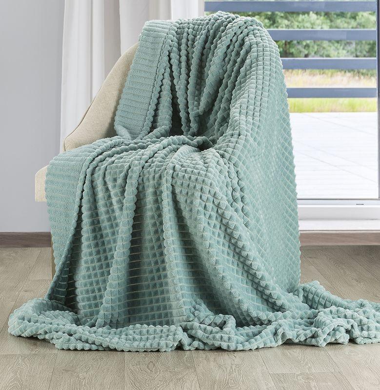 Moderní jemná a teplá deka se vzorem v krásné zelené barvě