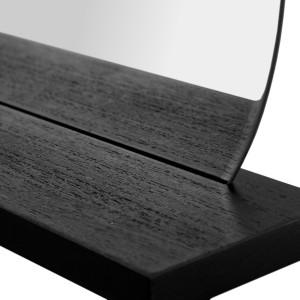 Moderní závěsné oválné zrcadlo osazené v černé poličce