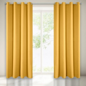 Moderní dekorativní zatemňující závěs ve žluté barvě