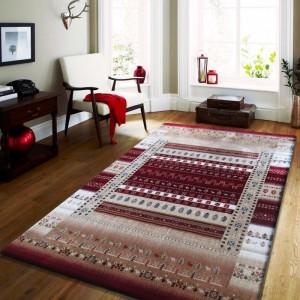 Luxusní koberec v béžové barvě s červenými vzory