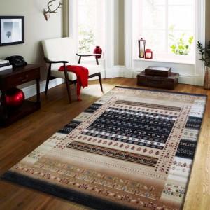 Moderní koberec s geometrickými vzory v modré barvě