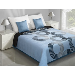 Oboustranný přehoz na postel modré barvy s ornamentem šedo-černých kružnic