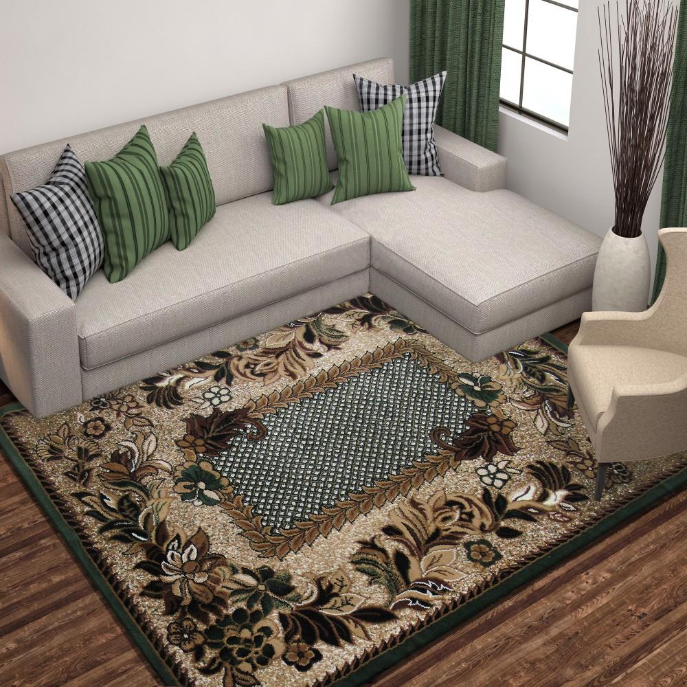 Stylový vintage koberec se zeleným okrajem
