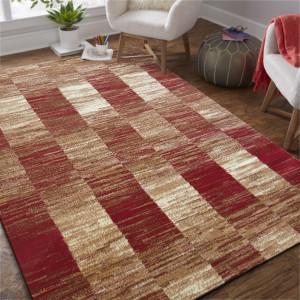 Kusový koberec v červené barvě do ložnice