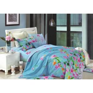 Modré povlečení na postel s barevným květovým vzorem