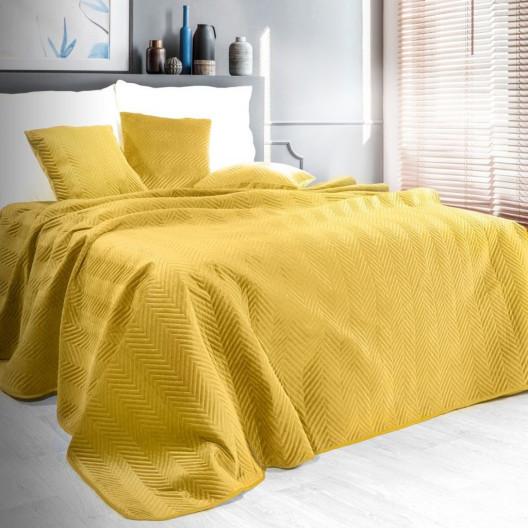 Oboustranný prošívaný přehoz na postel žluté barvy