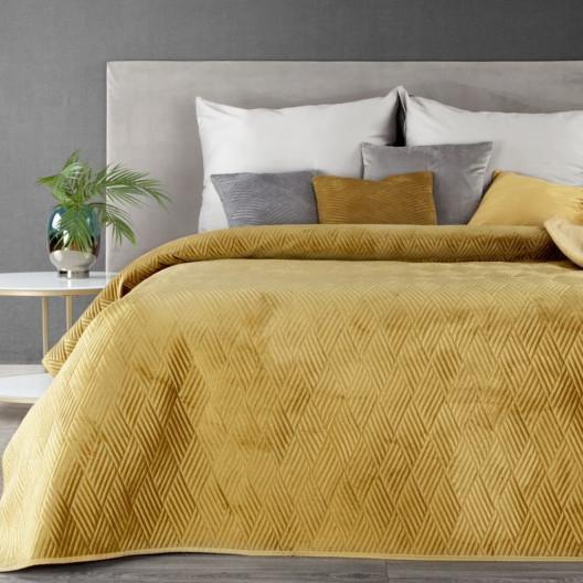 Krásný žlutý přehoz na postel s motivem geometrických tvarů