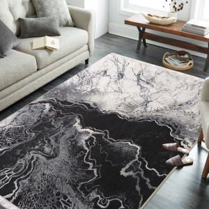 Protiskluzový koberec šedé barvy s abstraktním vzorem