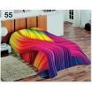 Barevná moderní deka přes postel s duhovým vzorem